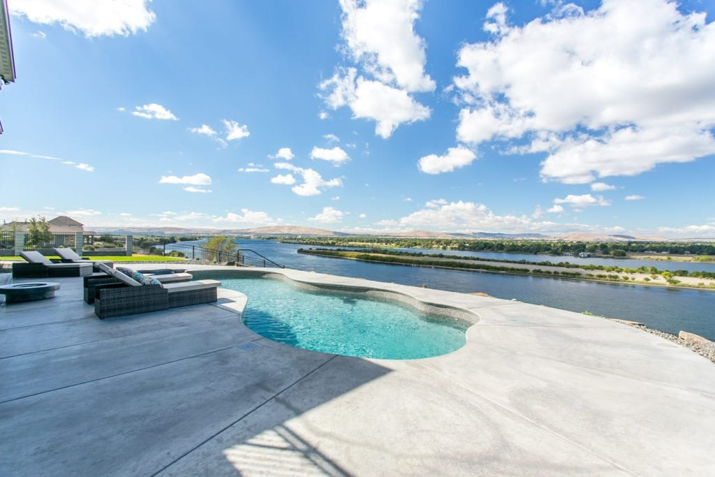 Pool overlooking the Columbia river in River Ranch Estates neighborhood in Pasco, Washington. Prodigy Homes, Inc. is building new construction homes in the Tri-Cities, Washington.