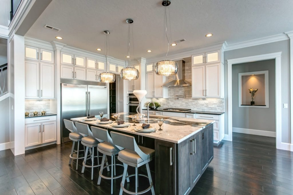 Kitchen trends. White kitchen with stacked stone backsplash. Bravo II home in Pasco, Washington. Prodigy Homes, Inc. is building new homes in Kennewick, Richland, West Richland and Pasco, Washington.