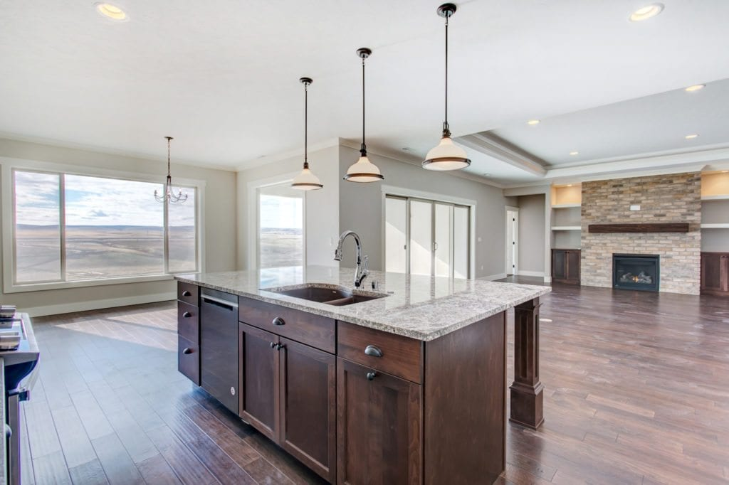 Kitchen trends. Warm, rustic kitchen with brown sink. Tempo II Modified home built in Southcliffe neighborhood in Kennewick, Washington. Prodigy Homes, Inc. is building new homes in Kennewick, Richland, West Richland and Pasco, Washington.