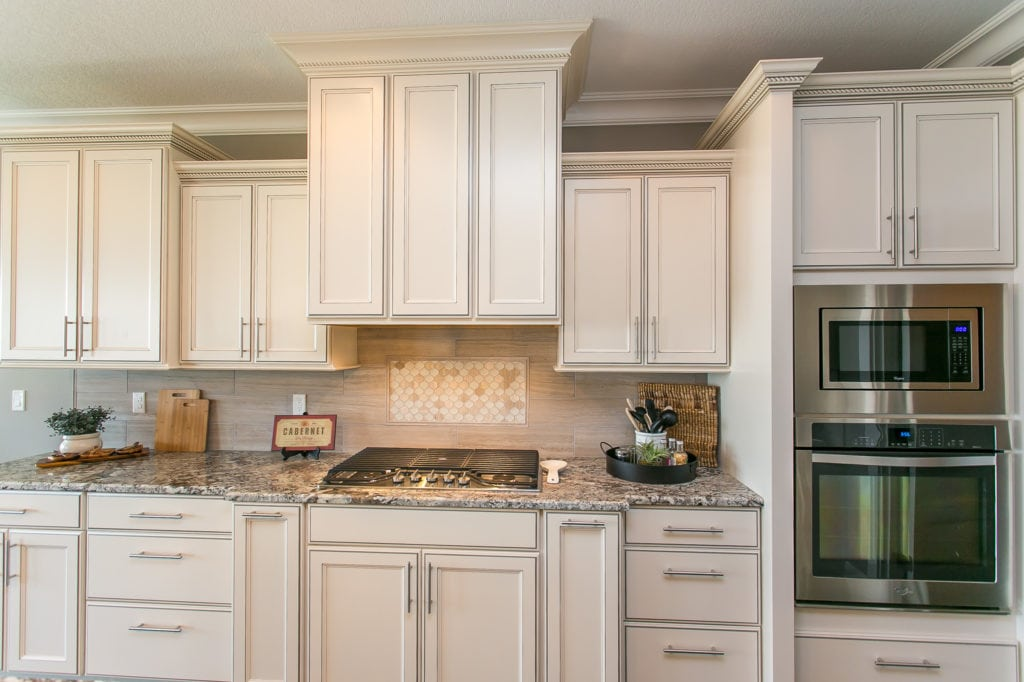 Eggshell kitchen cabinets in Westcliffe neighborhood in Richland. Prodigy Homes, Inc. is building new construction homes in Kennewick, Richland, West Richland, and Pasco, Washington.
