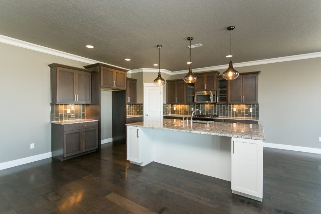 Stained wood cabinets in Sunset Ridge neighborhood in West Richland, Washington. Prodigy Homes, Inc. is building new construction homes in the Tri-Cities, Washington.