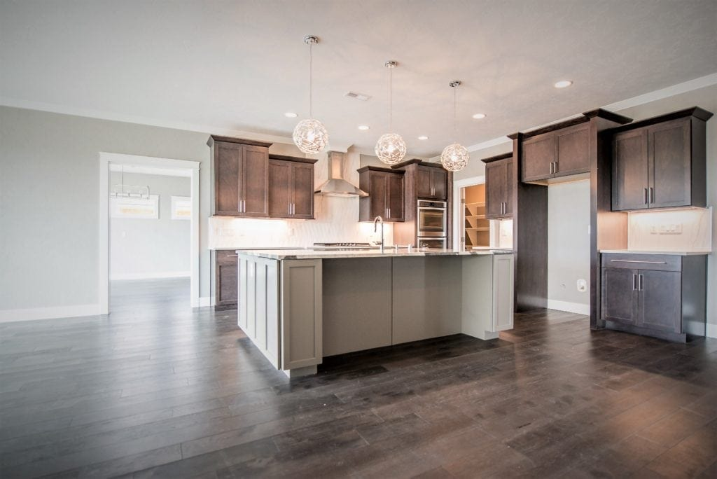 Ridgestone perimeter kitchen cabinets and phantom grey island. New home in Summitview neighborhood in Kennewick. Prodigy Homes is building new construction homes in the Tri-Cities, Washington.