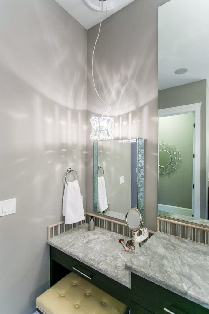 Master bathroom built-in vanity inspiration with pendant light. Located in Westcliffe neighborhood in Richland. Prodigy Homes, Inc. is building new construction homes in the Tri-Cities, Washington.
