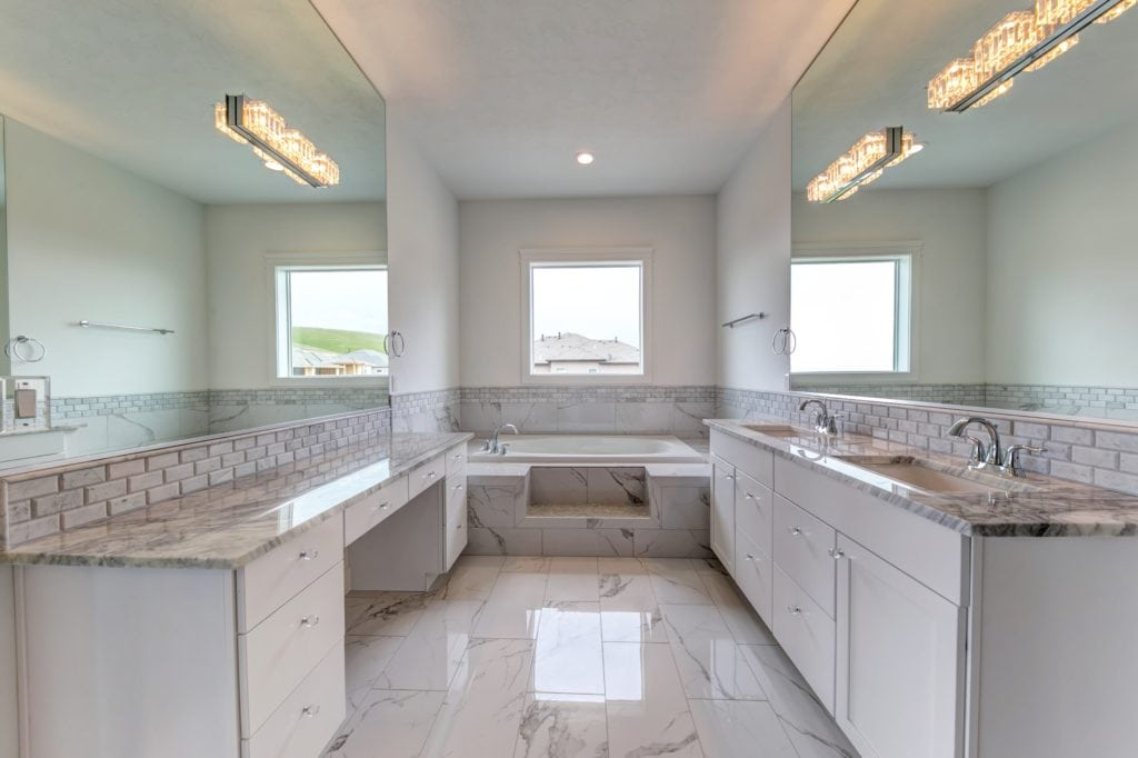All-white marble bathroom in Kennewick's Canyon Lakes neighborhood. Prodigy Homes, Inc. is building new construction homes in Kennewick, Richland, West Richland, and Pasco, Washington.