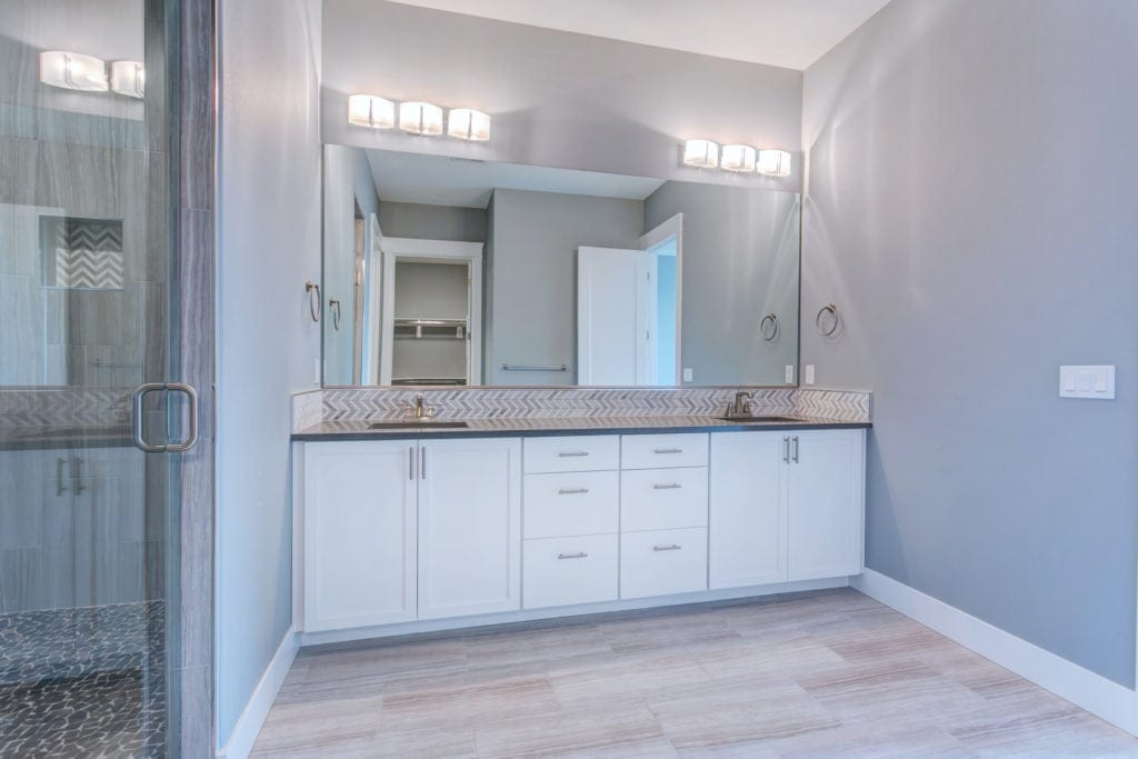 Master bath inspiration. Chevron backsplash. Prodigy Homes is building new construction homes in the Tri-Cities Washington.