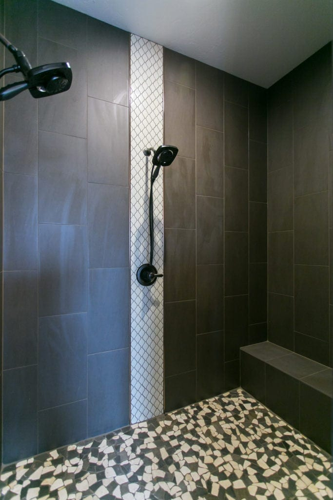 Beautiful, dramatic shower with dark tile in Westcliffe neighborhood in Richland. Prodigy Homes is building new construction homes in the Tri-Cities, Washington.