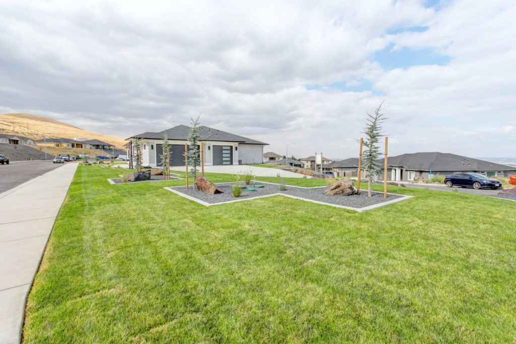 2018 Parade of Homes, Tri-Cities Washington. The Tempo Bonus plan with side-loading garage, from Prodigy Homes, Inc. Westcliffe neighborhood in Richland.
